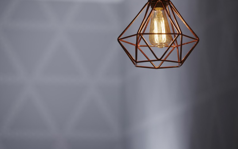 Copper cage pendant light with bespoke wallpaper