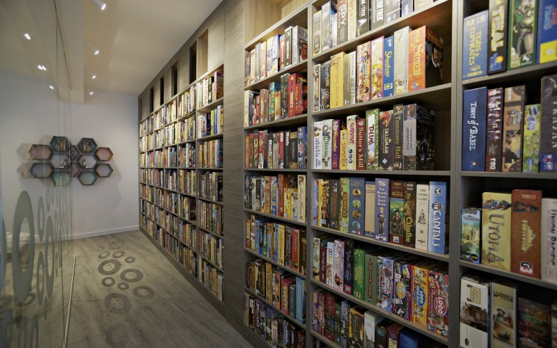 Boardgame library with hexagon shelves